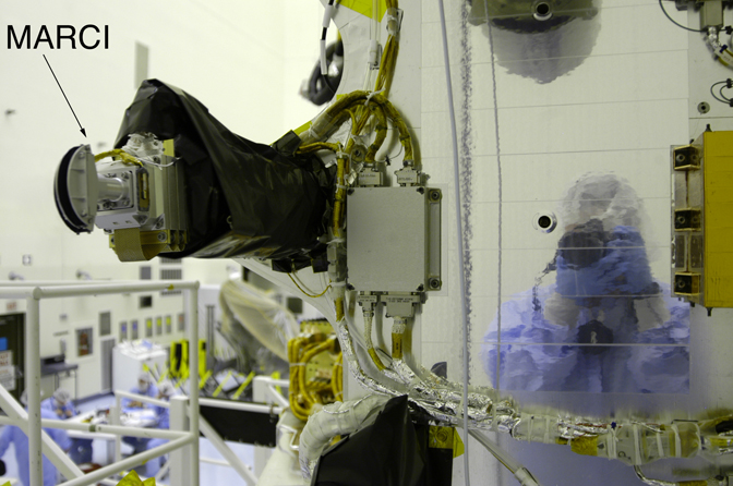 MARCI onboard the MRO spacecraft. Reflection on spacecraft body shows MSSS's Mike Ravine, the MARCI/CTX Instrument Manager, taking the picture.